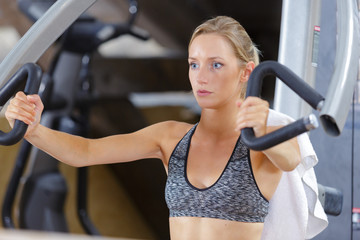 woman doing arm exercises in the gym