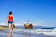 Tourist woman on beach enjoying vacation