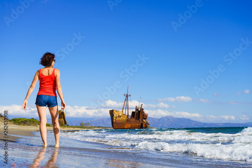 Tourist woman on beach enjoying vacation