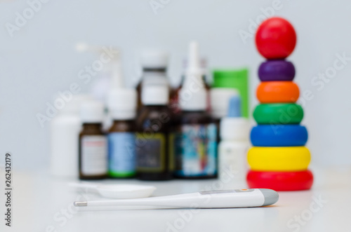 medicine bottles for children and a thermometer