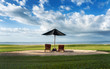 Relaxing scene of sun lounges and Parasol under a big sky in Fiji - 262449154