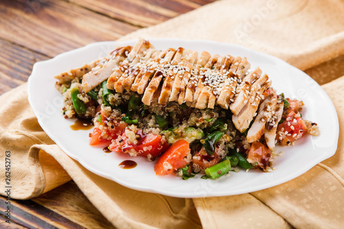 healthy salad with quinoa, vegetables and grilled chicken - 262452763