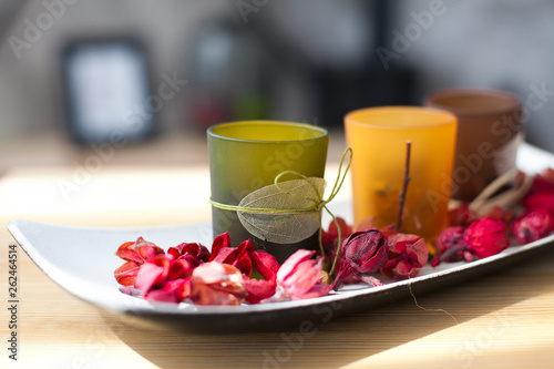 The decor. candles with rose petals © Arthur