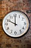 Classic Wall clock on brick wall