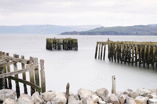 Old derelict wooden jetty pier in sea coast town of Helensburgh Argyll © Richard Johnson
