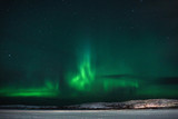 green northern lights over the tundra filmed on a long exposure in a frosty clear night