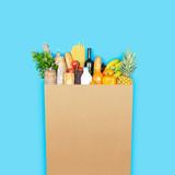 Fototapeta Kawa jest smaczna - Grocery shopping bag with assorted products © stokkete