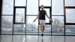 Full length view of sportsman jumping with skipping rope in gym
