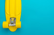 minimalist flat lay photo of cruiser skateboard over turquoise blue background