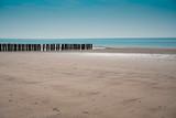 north sea coastline of Burgh Haamstede with breakwaters, The Netherlands