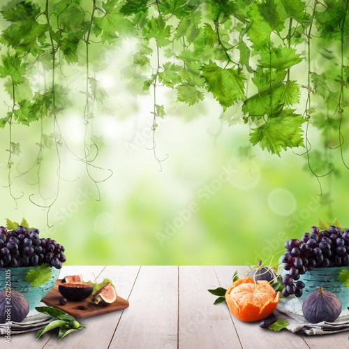 Fruit on light wooden table in sunlight garden. Natural morning background - 262525305