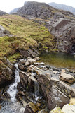Waterfall on the Cwmorthin Waterfall trail in the mountains of Snowdonia National Park, Wales.