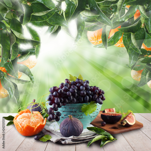 Fruits on wooden table garden. Natural tangerines in green sunlight morning background - 262531339