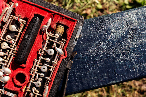 Musical wind instrument oboe in original red case. Place for text. - 262535710
