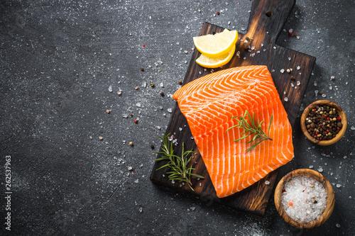 Leinwandbild Motiv Salmon fillet with fresh vegetables and spices.