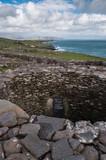 Beehive Hut ancient dwelling on Dingle peninsula. Dingle, Ireland. March 2019