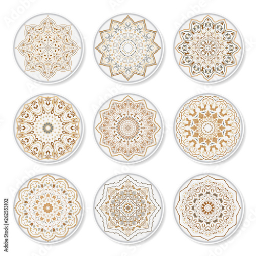 Nine plates with ornate Arabic pattern, top view on white background.