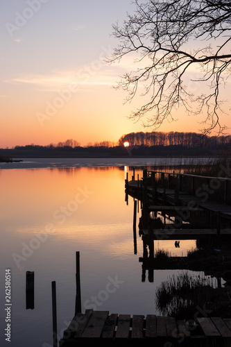 Acrylglas Pier tranquil lake view with jetty at sunset