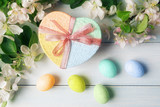 Gift box and Easter eggs with apple tree branches