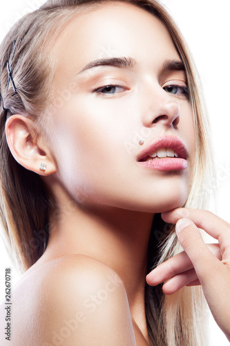 canvas print picture Close-up beauty face of model girl with healthy skin, natural make-up, hand near chin. Young model woman with beauty spot near lips. Isolated over white background. Facial treatment concept