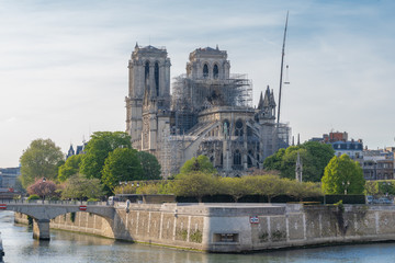 Paris, France - 04 17 2019: The day after the fire at Notre-Dame Cathedral. View from the banks of the Seine