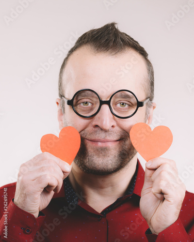 canvas print picture Man in love holding hearts