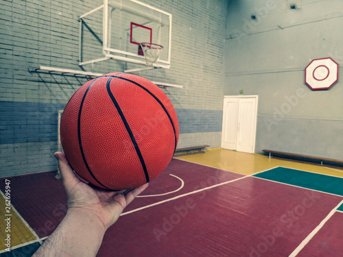 Fototapeten Basketball basketball. basketball court. hand and ball. throw in the basket