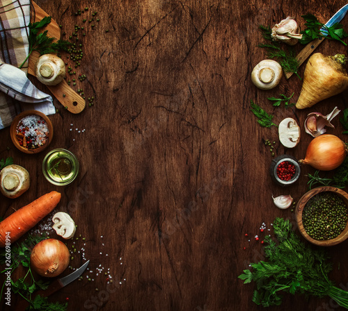 canvas print picture Food cooking background. Ingredients for prepare green lentils with vegetables, spices and herbs, wooden kitchen table background, place for text. Vegan or vegetarian food oncept. Top view, border