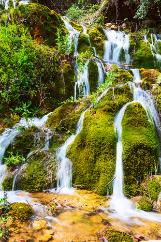 Beautiful waterfall cascade in the forest, spring nature background - 262708722