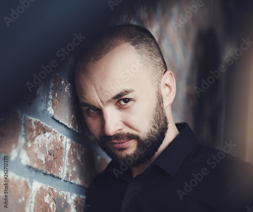 canvas print picture close-up of a beautiful bearded man in the studio