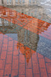 Reflection of the building on puddle