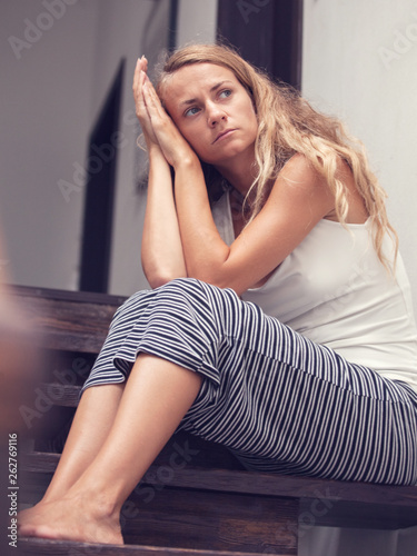 Leinwandbild Motiv Sad woman at home