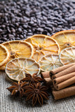 coffee beans with citrus cinnamon sticks and star anise on the background of burlap