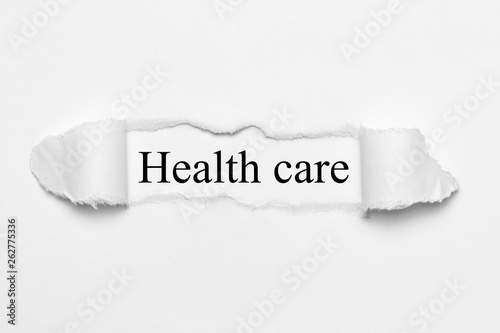 canvas print picture Health care on white torn paper