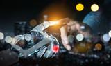 Fototapeta Coffie - Robot hand making contact with human hand on dark background 3D rendering © sdecoret