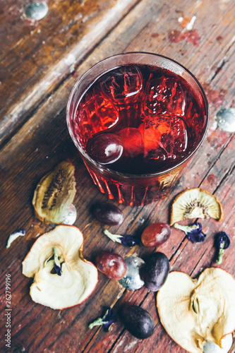Coctail on the wooden background © Tetiana