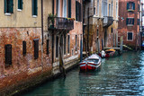 Canal in Venice with traditional old houses, Italy