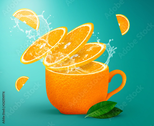 Orange tea splashing creative concept for poster, flyer, banner. Fresh orange juice or tea. Freshly squeezed orange - 262814976