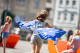 Cute happy young girl with the flag of the European Union