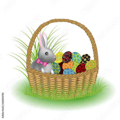 A gray cute rabbit is sitting in a basket with painted Easter eggs. The symbol of Easter in the culture of many countries. Vector illustration. © Nataliia