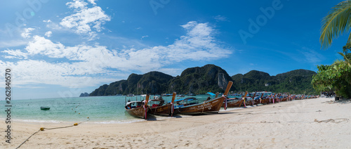 Thailand, Phi Phi Island, December 2018 - Long boats on the shore, near the harbor - 262840570