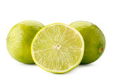 Ripe limes and half close-up on a white. Isolated.
