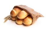 Mini brioche bun in paper bag isolated on white