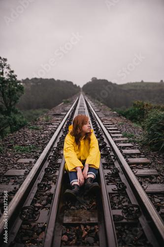 Girl in the train tracks