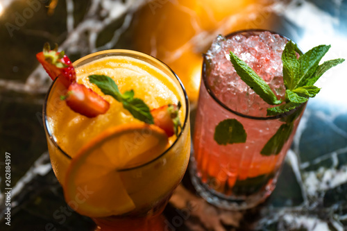 Two Delicious Orange, Strawberry Summer Cocktail, Close View © 0804Creative