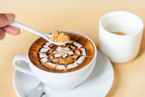 Add sugar to hot coffee / add sugar to hot cappuccino