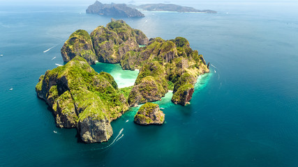 Aerial drone view of tropical Ko Phi Phi island, beaches and boats in blue clear Andaman sea water from above, beautiful archipelago islands of Krabi, Thailand
