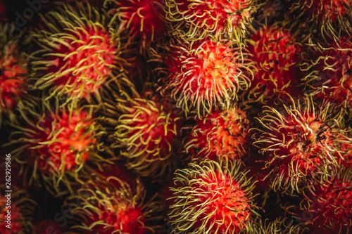 Healthy fruits rambutans background, Red Healthy fruits rambutans, rambutans in a supermarket  - 262929586