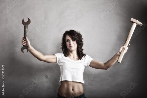 canvas print picture Sexy girl holding hammer and wrench spanner