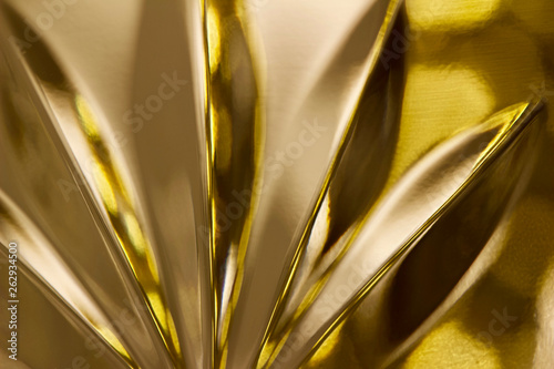 Macro abstract view of beautiful hand-cut lead crystal glass reflecting golden bokeh - 262934500